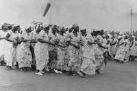 Fig. 3: Photograph of Women in the British Southern Cameroons wearing the Kamerun National Congress cloth while rallying in support of the KNC, ca. 1950s.