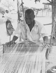 Fig03_01.  Hausa man weaving on wide-width horizontal loom in a northern Nigerian village.
