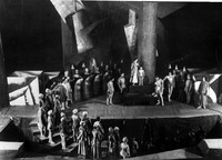 In this photograph from scene 7 of The Dawns, Meyerhold and Bebutov bridge the forestage and audience with a chorus of actors who form an unbroken human link between the two.