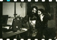 Carolee Schneemann and Felipe Ehrenberg with mimeograph machine and cat.