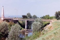 The Bridge at Arcole and 1810 Monument (photo by author). As can be seen from this photograph, the Alpone River itself is not a formidable obstacle, but the dikes on either side make it virtually impassable except by bridge, making this location strategically important during the Italian campaign.