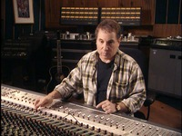 Fig. 6.1. Paul Simon sitting at a mixing board in a recording studio, manipulating the controls and listening intently.