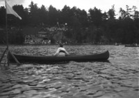 A woman races in a solo open canoe class in 1922 at a regatta in Chemong Park just north of Peterborough.