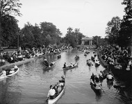 Courting on Grand Canal in Belle Isle Park in the Detroit River, with Detroit, Michigan, on one side and Windsor, Ontario, on the other, ca. 1900. Note the Victrola mounted in the canoe in the foreground.
