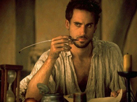 Joseph Fiennes as Shakespeare writing in his garret, Shakespeare in Love (Miramax Films / Universal Pictures, 1998).