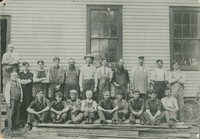 Workers at the Rushton Boat Shop in 1905. J. Henry Rushton stands at the lower left.
