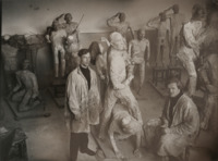 This photograph shows the Inspector General dumb show mannequins, made by V. M. Petrov, in the process of being created. The bodies are newspaper papier-maché over wire armatures, while the faces (with surprised expressions) are wax. The figures are permanently attached to the small platforms on which they later stood at the end of the production.