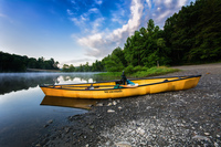 Wenonah continually experimented with new models, including this solo canoe called the Vagabond, seen on the shore of Abel Lake in Virginia. Solo canoes became popular for wilderness trippers and day paddlers alike.