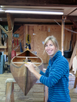 Emily Schoelzel restoring a 1964 Old Town OTCA canoe in the Salmon Falls Canoe shop.