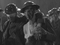 "Figure 1.4. The Marching Wounded. Film still of wounded soldiers from the sequence accompanying the song ""Remember My Forgotten Man,"" in Gold Diggers of 1933 (Warner Brothers)"