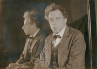 Photograph of Meyerhold taken in front of a mirror so that both his face and profile can be seen simultaneously.