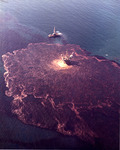A color photograph depicting the extent of the oil spill in the water.