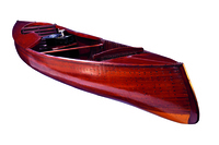 "This 16-foot ""Comfort Craft"" courting canoe was built by the Peterborough Canoe Company in 1904. Also known as the ""Girling Canoe,"" it came equipped with lockers under the side decks for a phonograph and records. The front seat faced the stern of the canoe."