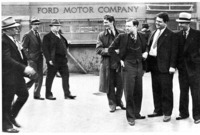 Ford Security men (LEFT) and UAW men at the Rouge just before the Battle of the Overpass. Walter Reuther and Richard T. Frankensteen are second and third from the right.