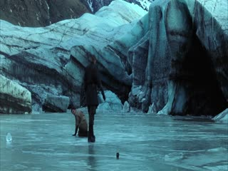 In this film clip from the movie Batman Begins Bruce Wayne (played by actor Christian Bale) and Ducard (played by actor Liam Neeson) are fighting on an iced-over lake in the mountains using swords. Ducard knocks Bruce Wayne down multiple times as Bruce Wayne fails to adequately defend himself until finally he succeeds in knocking Ducard down and Ducard is pleased.