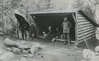 Dr. Arpad Gerster, a prominent New York surgeon, vacationed with his family in the Adirondacks during the 1890s. Here, Gerster portages a Rushton pack canoe at Camp Oteetiwi, Big Island, Raquette Lake.