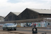 Large warehouses used for storing textiles near Kano market.