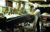 A worker at Old Town Canoes puts the finishing touches on a fiberglass model.