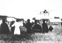 Villagers greet a passing aviator during the St. Petersburg–Moscow air race, July 1911.