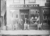 The George A. Gray hardware store of Old Town, Maine, in 1906. George Gray stands at the far left.