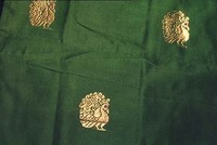 This Paturu (near Nellore) sari is distintive for its use of embroidered patterns throughout the body of the sari, and for its relatively unadorned pallu.