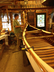 Tom Seavey attaching the extended outwale to the canvassed Veazie canoe.