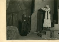 Black-and-white photograph of two actors portraying a beggar and a possessed woman.