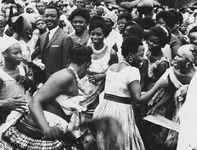 Fig. 7: Photograph of Anna Foncha surrounded by women dancing a local West Cameroon dance.