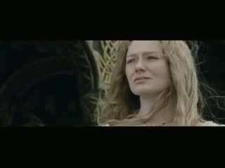 "This video edits together footage from the Lord of the Rings trilogy of a beautiful blonde-haired character, ""Éowyn,"" and her uncle, an older long-haired character, ""Théoden."" The video shows many tender moments as she tends to her uncle, leaning over his dying body, stroking his old, wrinkled hand, bringing him drink, etc. The video also shows her mourning her dead brother and various scenes in which she is alone and upset. We also see her preparing to battle, unsheathing a sword, riding into battle, and killing another character by thrusting the sword into his helmet. The video ends with a shot of a falling white flower."
