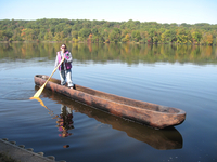 Alice Zalonis Brylawski stands in a dugout canoe at a Wooden Canoe Heritage Association MiniAssembly at Gifford Pinchot State Park in Pennsylvania in 2012.