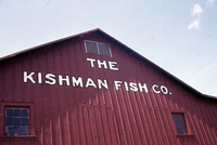 A color photograph of the exterior of Kishman Fish Co. building.