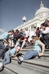 Amid a circle of onlookers Jennifer Keelan, eight, crawls up the Capitol steps.