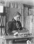 Helen Keller at her typewriter in her Cambridge, Massachusetts, home while a student at Radcliffe, 1900.