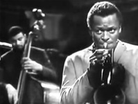Figure 14. Miles Davis looks off to his right as if distracted while playing the composed section of the piece, suggesting that doing so requires little concentration.