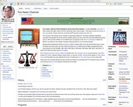 "A page from the Wikiality website dedicated to Fox News. The page includes a lot of satirical, fictitious information about Fox News, including describing Fox News as ""Our Leader's Glorious Official Republican Government News Network,"" stating that it was founded ""one day after Rupert Murdoch became a US citizen,"" and that the CEO is ""the holy ghost."" The Wikiality logo also features a circle made out of puzzle pieces that form Stephen Colbert's face."