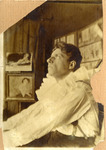 Photograph of Meyerhold, in profile, eyes gazing upward, in the white costume of Pierrot.