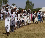 Several students, wearing Fulani-style garments, presenting a dance skit at school graduation.