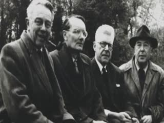 "A short clip from the documentary ""J.R.R. Tolkien: Origins of Middle Earth"" that cuts between various old photographs of Tolkien and his friends/contemporaries and the Eagle and Child Pub in Oxford, England and the talking-head style interviews of Rayner Unwin, Tolkien's publisher, and another scholar."