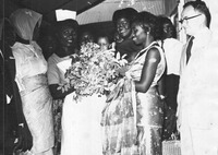 Fig. 1: Photograph of Anna Foncha receiving flowers from local women in West Cameroon, ca. 1960s.