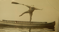 A photograph of Jule Fox Marshall, balancing on a canoe.