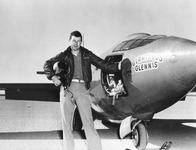 Fig. 5. Test pilot Chuck Yeager in flight gear, helmet under his arm, standing next to the X-1 rocket plane.