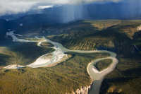 A color photograph of an aerial view of the Nahanni River.