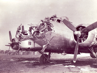 Flak from anti-aircraft guns protecting the German city of Cologne destroyed the nose of this B-17.