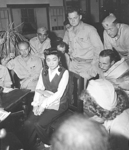 American reporters surround Iva Toguri at her September 1945 press conference in Yokohama.