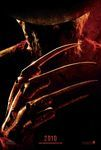 "A film poster for the 2010 remake of the film Nightmare on Elm Street, with a close-up of the ominous character Freddy Krueger, reflecting firelight with a large claw-like metal hand with knives for fingers. The numbers ""2010"" and the website ""www.nightmareonelmstreet.com"" appear in red at the bottom of the poster."