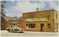 A color postcard depicting the Canoe Country Outfitters shop.