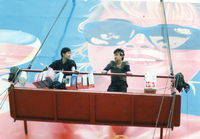 Photograph of Mansu (left) and Ch'ilsu (right) at work on the billboard that forms the backdrop to the famous final sequence of the film.