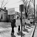 John Lewis (left), Archie E. Allen, and other students representing the Nashville Christian Leadership Council protest on Jefferson Street in Nashville during the Freedom March, March 23, 1963.