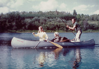 John McPhee poling a canoe with his daughters Jenny (in the bow) and Martha (in the middle) in Ontario in 1978.