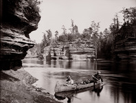 Canoeists in a birch-bark canoe near Steamboat Rock, Wisconsin Dells.